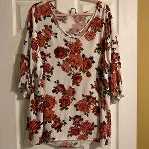 White blouse with red floral detail from Torrid